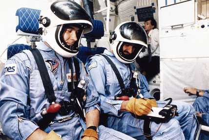 Astronauts aboard Shuttle Discovery, 1985.