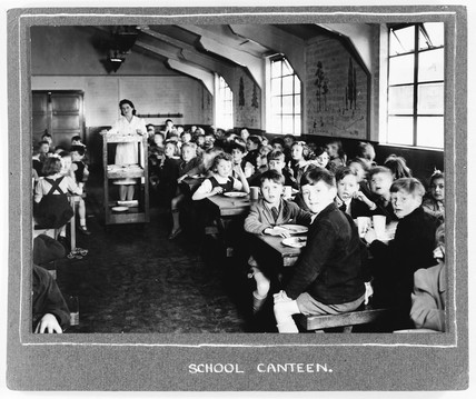 School canteen, 1940s. Children eating scho