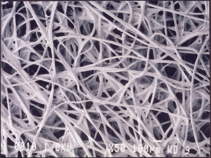 Chemotextile cloth, light micrograph, 1990s.