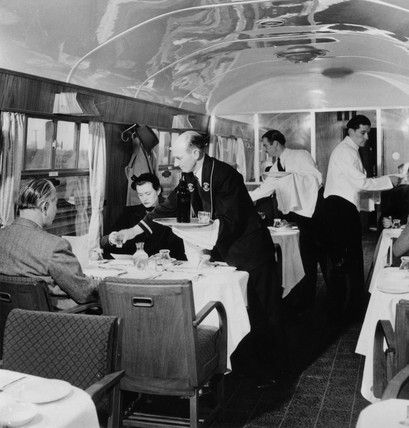 British Railways Stewards serving drinks in the First Clas dining car, 1951.