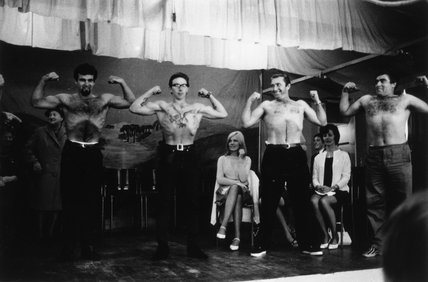 Four male contestants in strongman contest, 1967.