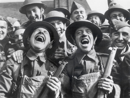 British soldiers laughing during an open air concert, c 1942.