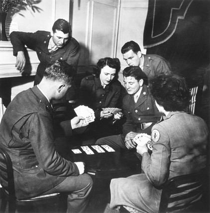 Soldiers and welfare girls playing cards, World War Two, 1942.