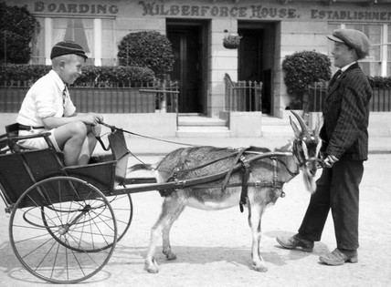Boy in a goat-cart, c 1930s.