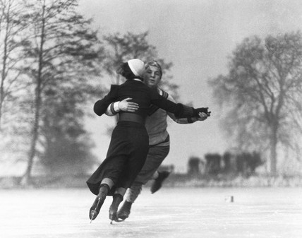 Couple skating on an ice rink, c 1930s.