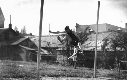 High jumper in action, c 1920s.
