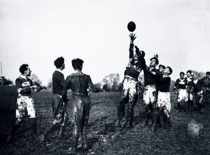 Rugby players jumping for the ball during a line-out, c 1920s.