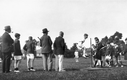Schoolboy doing the high jump on sports day, c 1920s.