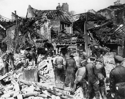 Searching the wreckage of houses for victims, Second World War, c 1942.