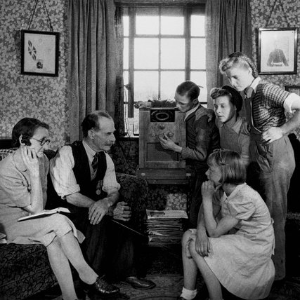 Family listening to a speech by Winston Churchill, 19 May 1945.