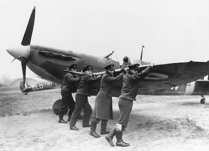 Airmen wheeling out a Spitfire, 26 February 1942.