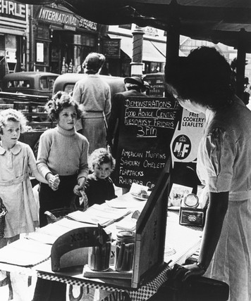 Children at a Ministry of Food market stall, World War Two,  17 June 1944.
