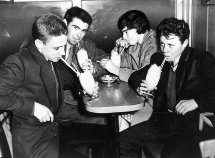 Teddy boys and girl drinking milk shakes, 21 October 1959.