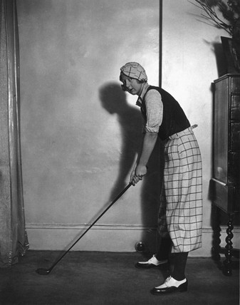 Woman modelling the latest golfing fashions, 16 February 1933.
