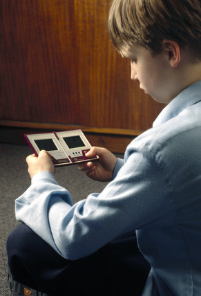 Child playing a computer game, 1997.