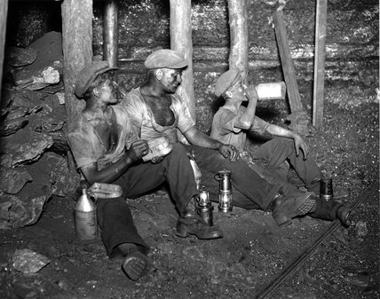 Coal miners taking their twenty minute rest, South Wales, 24 June 1931.