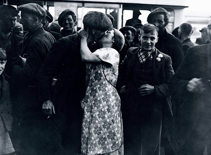 'Stay-in' strikers returning to their families, Wales, 1936.