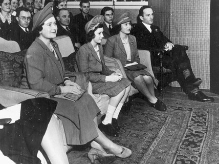 Queen Elizabeth and princeses watching a play, 18 December 1942.