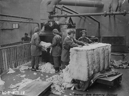 Bale breaking at stores, Dornock, Gretna munitions factory, Scotland, 4 July 1918.