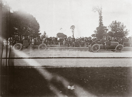 J E Hutton and C S Rolls finishing the 50 Guinea Cup, Phoenix Park, Dublin, 1903.