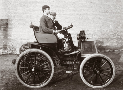 C S Rolls sitting in the first car in Britain fitted with wheel steering, 1898.