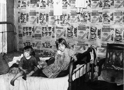 Children in the bedroom of their home, West
