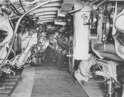 Sailors at work in the interior of a British submarine, 1914-1918.