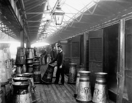 Midland Railway porters unloading milk at Somers Town dock, c 1890.