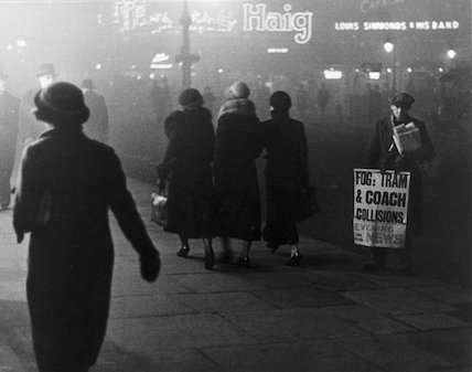 Fog scenes in central London at night, 1934.
