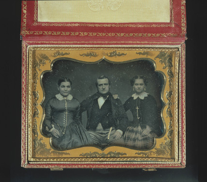 Daguerreotype portrait of two ladies and a gentleman, c 1850.