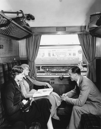 Pasengers in a smoking carriage, Great Western Railway, 1936.