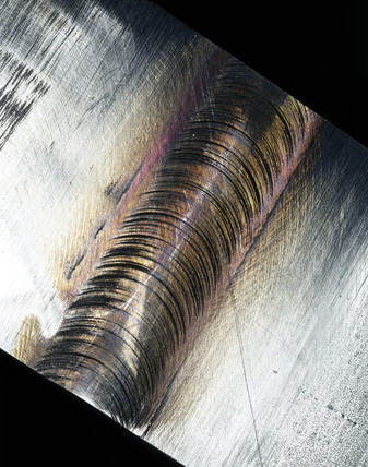 Piece of steel showing a friction stir weld join, 2000.