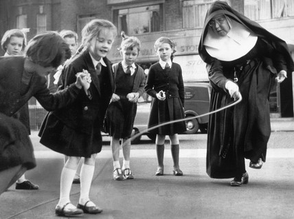 A nun teaching her pupils to skip, 27 October 1959.