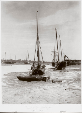 'Small sailing vesels grounded at low tide', Chiswick, London, 1901.