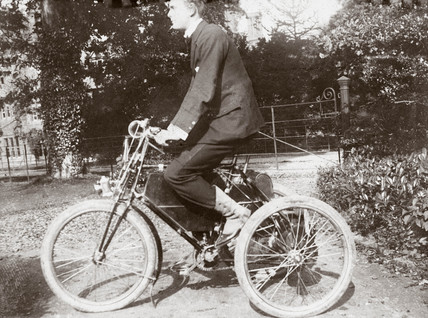 C S Rolls sitting on a de Dion tricycle, 1897.