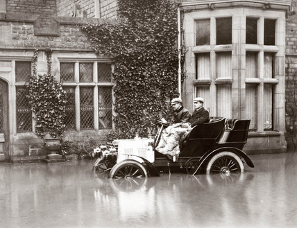 C S Rolls and Colonel M Mayhew in a Napier motor car in flood water, 1900.