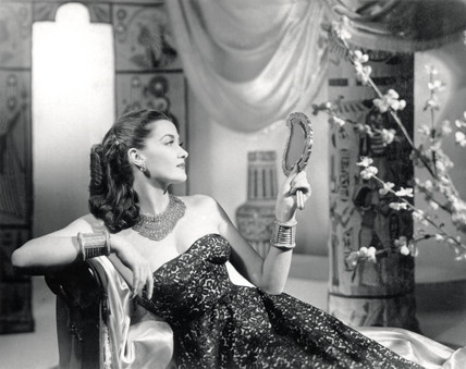 Glamorous young woman reclining on a couch, c 1945.