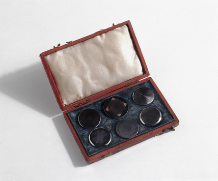Set of buttons engraved with diffraction patterns by John Barton, c 1825.
