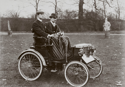 C S Rolls (left) and pasenger in a Peugeot Voiturette motor car, c 1900.
