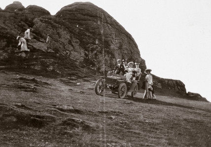 The first 10 hp Rolls-Royce motor car parked beside Hay Tor, Devon, 1904.