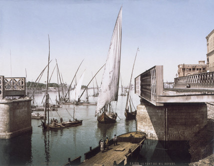 Dhows sail by an open swing bridge on the River Nile, Cairo, Egypt, c 1920s.