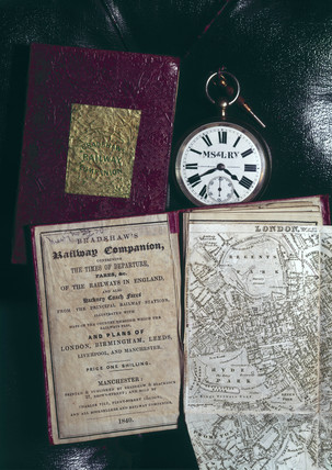 Pocket watch with a copy of Bradshaw's Railway Companion, 19th century.