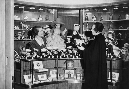 Shop on the 'Queen Mary' selling dolls dresed as sailors, 28 May 1936.