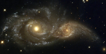 A grazing encounter between two spiral galaxies, 1999.