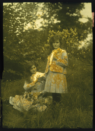 Autochrome of two young ladies with matching hair and outfits, c 1910.