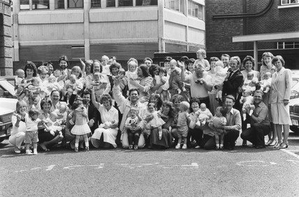 Dr Brian Lieberman and twenty six 'test tube' babies, June 1987.