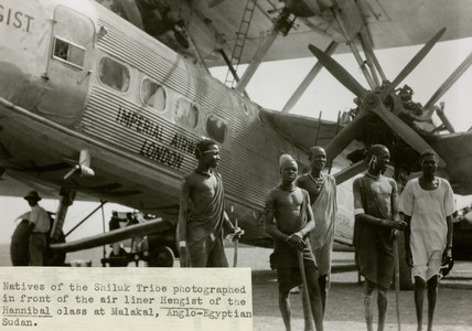 HP42 G-AAXE 'Hengist' with natives of the Shiluk tribe, Sudan, c 1930s.