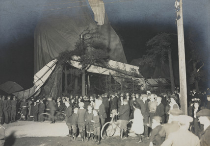 Crowds gathered round balloon disaster, c 1920s.