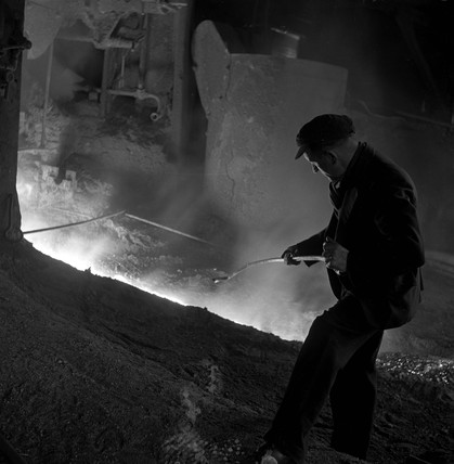 Unprotected steelworker with molten iron, Workington, 1952.