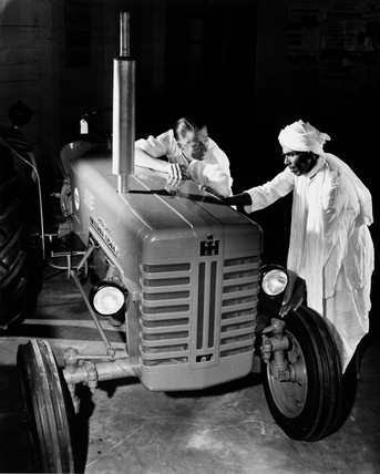 A farmer contemplates the purchase of a tractor, Guyana, 1958.